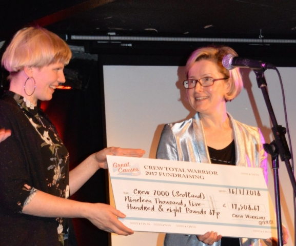 Sophie Temple presents Crew CEO Emma Crawshaw with the fundraising total for the event, an amazing £19,508